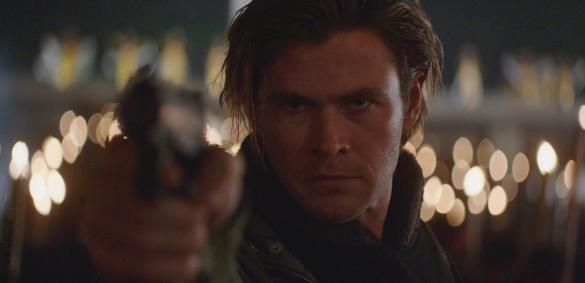 Chris Hemsworth is a hacker who can also masterfully shoot guns in