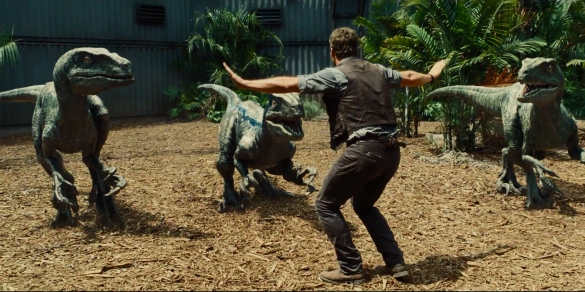 Chris Pratt with raptors in JURASSIC WORLD