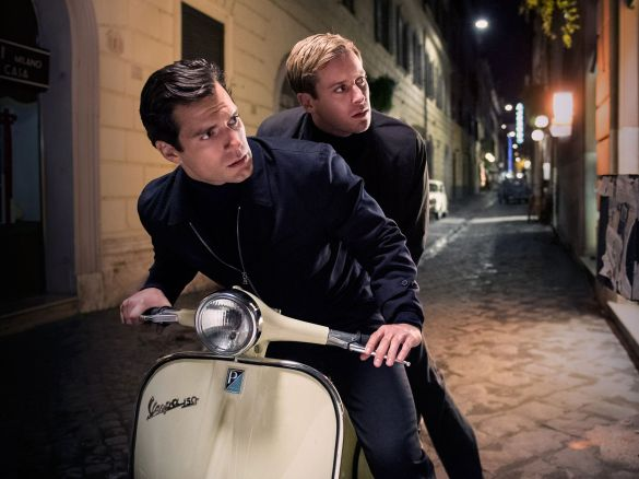 Henry Cavill and Armie Hammer on a scooter in THE MAN FROM U.N.C.L.E.