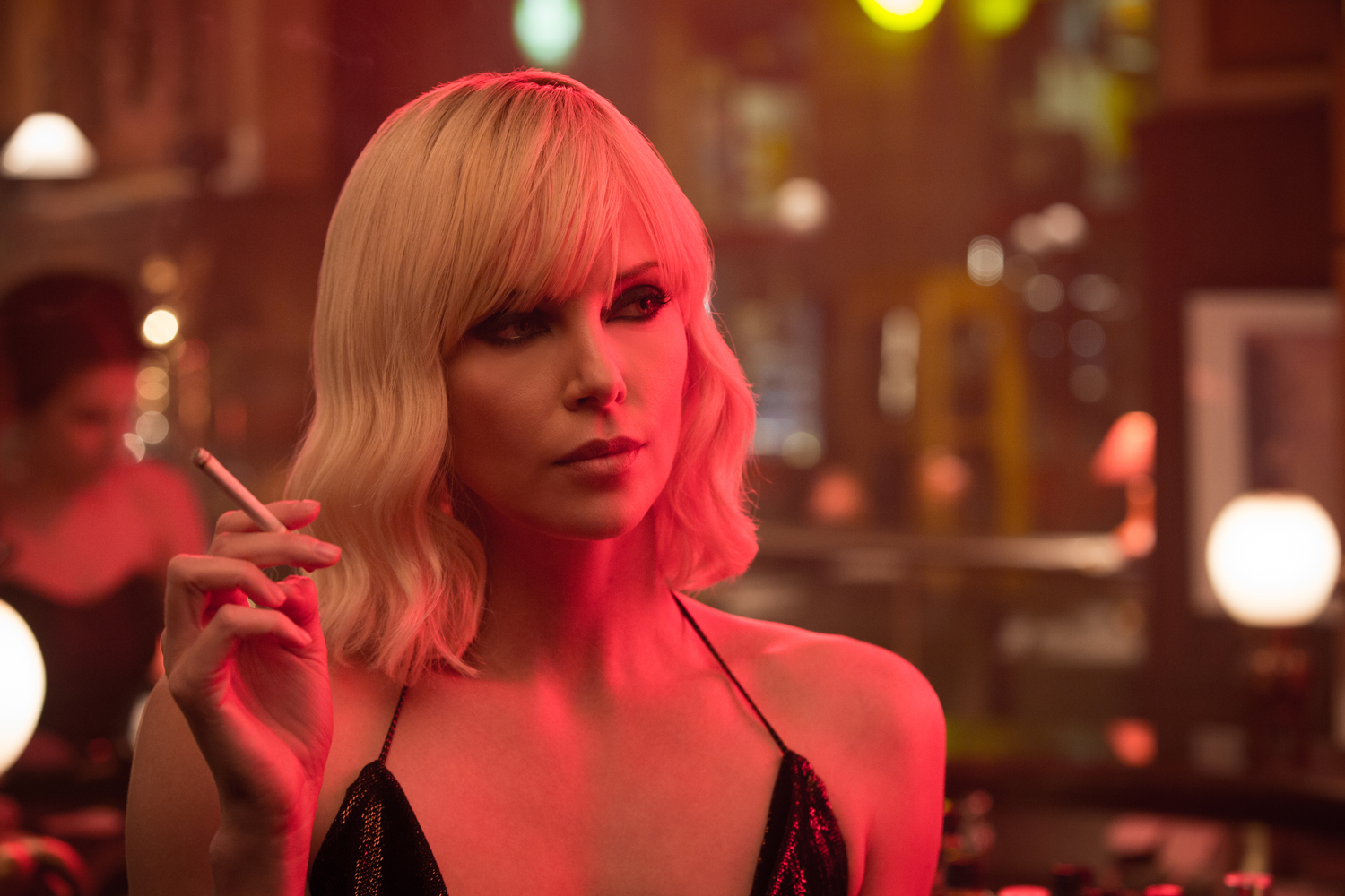 Charlize Theron smoking a cigarette in ATOMIC BLONDE