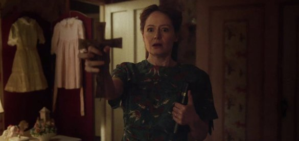 Miranda Otto tries to ward off demons in ANNABELLE: CREATION.