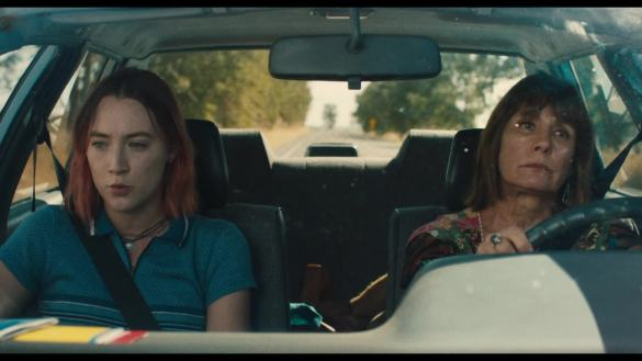 Saoirse Ronan and Laurie Metcalf riding in a car together in the coming-of-age movie LADY BIRD.