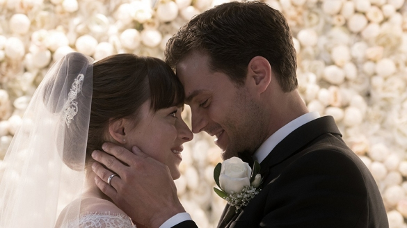 Dakota Johnson as Anastasia Steele and Jamie Dornan as Christian Grey at their wedding in FIFTY SHADES FREED.