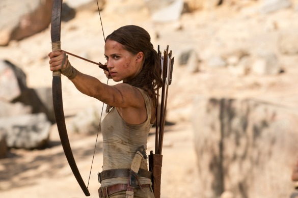 Alicia Vikander poised to fire an arrow in TOMB RAIDER.