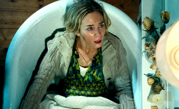 Emily Blunt hiding in a bathtub in A Quiet Place.