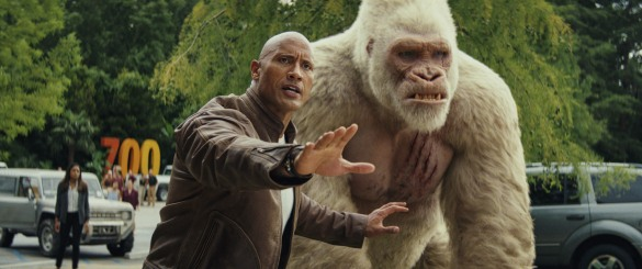 Dwayne Johnson with the giant ape George in RAMPAGE.