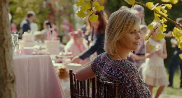 Charlize Theron stares off into the distance at a wedding in the film TULLY.