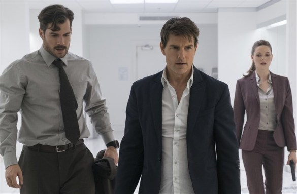 Henry Cavill, Tom Cruise, and Rebecca Ferguson looking exhausted, recover from a bathroom fight scene in MISSION: Impossible - Fallout.