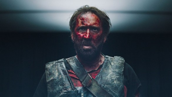 Nicholas Cage looking angry, covered in dried blood in the film Mandy