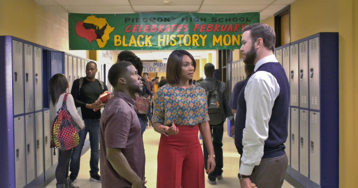 Kevin Hart and Tiffany Haddish standing in a high school hallway talking to Taran Killam in the movie Night School.