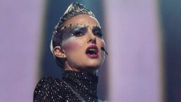 Natalie Portman singing in futuristic makeup in the film Vox Lux