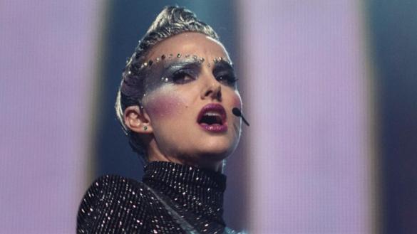 Natalie Portman singing in futuristic makeup in the film Vox Lux