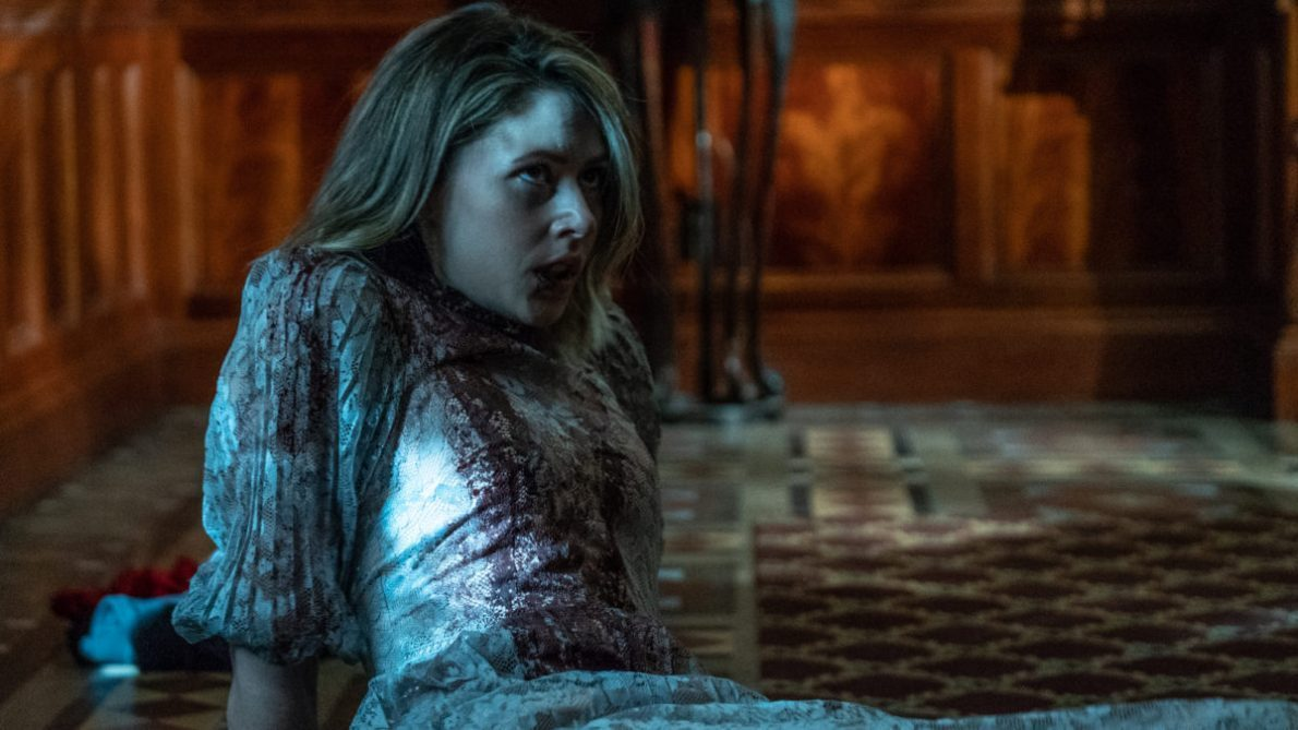 Amanda Crew looks bloodied and beaten in the movie Tone-Deaf