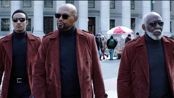 Jessie T. Usher, Samuel L. Jackson and Richard Roundtree dressed in sunglasses and red coats with black turtlenecks in the movie Shaft