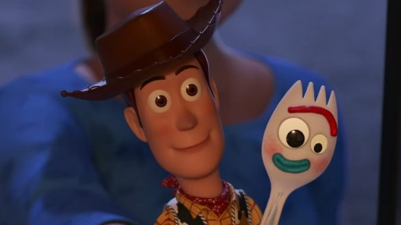 Woody and Forky being held by an adult in TOY STORY 4