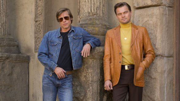 Brad Pitt and Leonardo DiCaprio in Once Upon a Time in Hollywood wearing period clothes and looking cool.