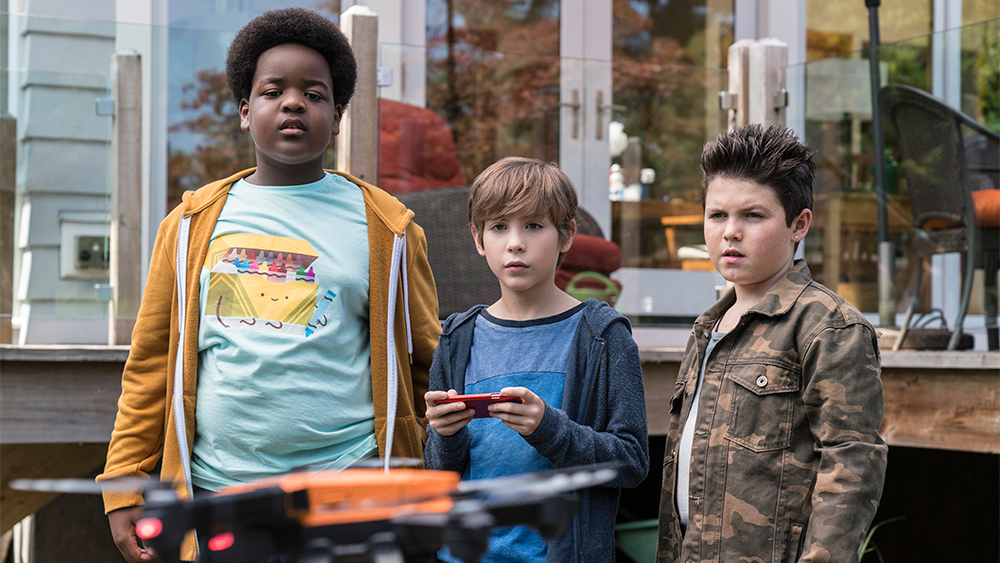 Keith L. Williams, Jacob Tremblay, and Brady Noon try to pilot a drone in the movie Good Boys