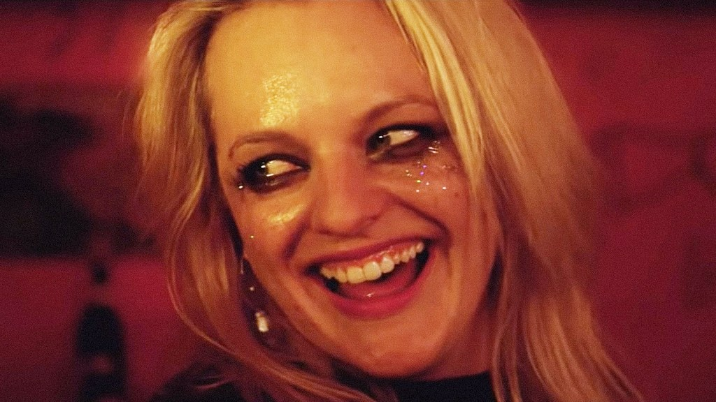 Elisabeth Moss in the movie Her Smell grinning and looking away covered in sweat and glittery makeup