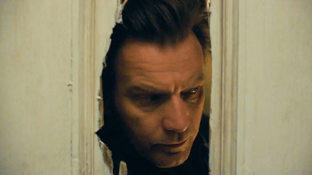 Ewan MacGregor peers through an axe hole in a door originally featured in The Shining, in the movie Doctor Sleep.