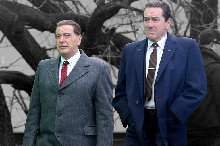 Al Pacino and Robert De Niro standing together wearing shirts ties and jackets in Martin Scorsese's movie The Irishman