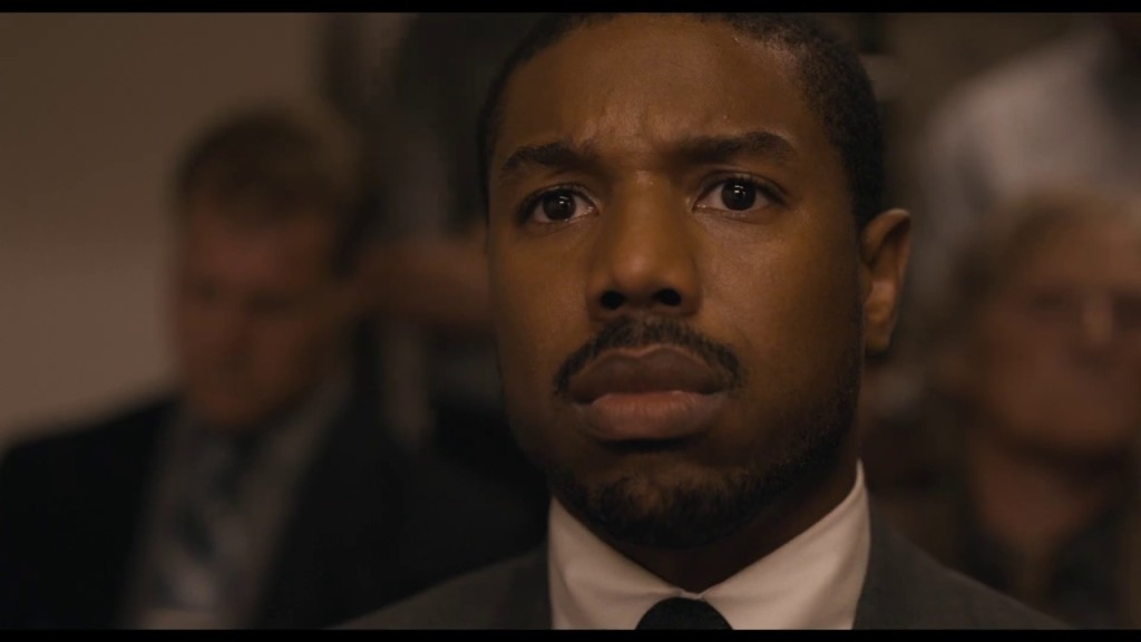 Michael B. Jordan looking worried in the movie Just Mercy