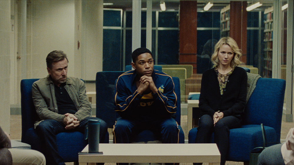 Tim Roth, Kelvin Harrison Jr and Naimo Watts anxiously await a parent/teacher conference in the movie Luce by Julius Onah.