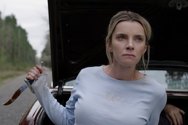 Betty Gilpin holds a knife angrily in the movie The Hunt