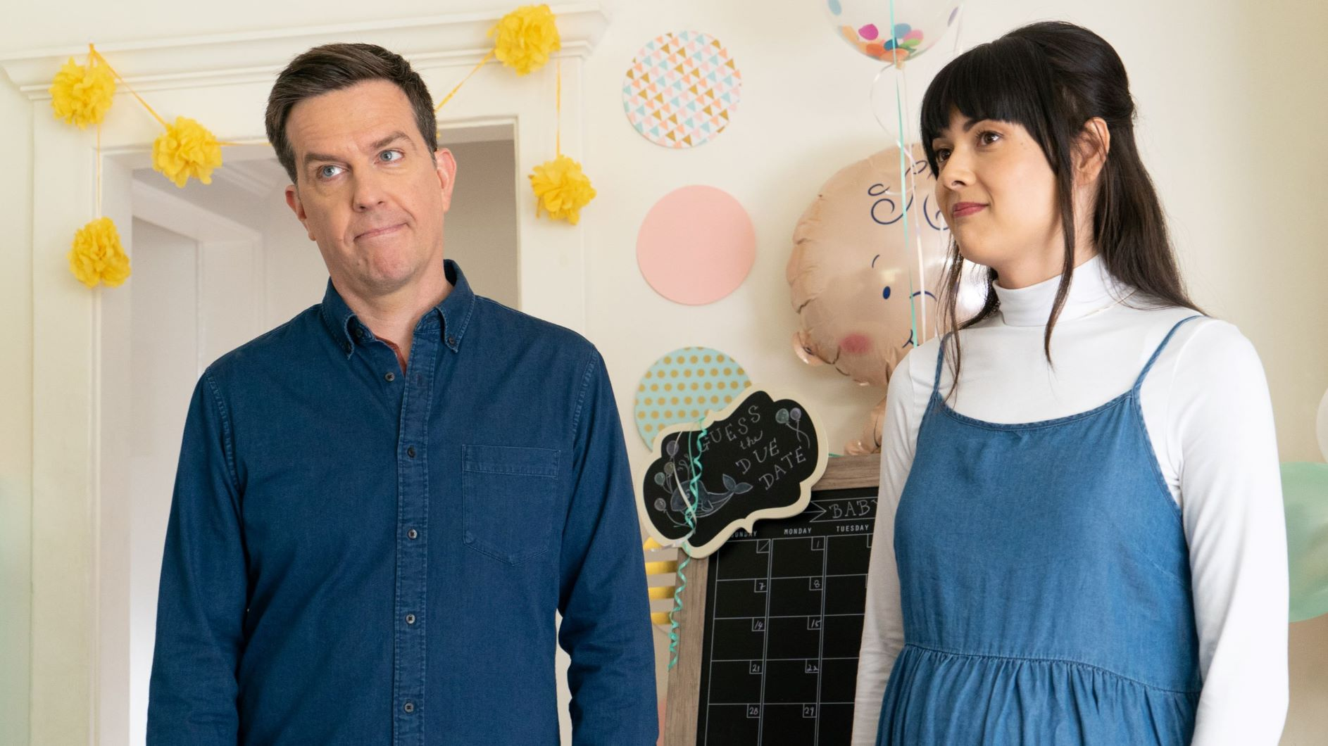 Ed Helms and Patti Harrison stand together in the movie Together Together