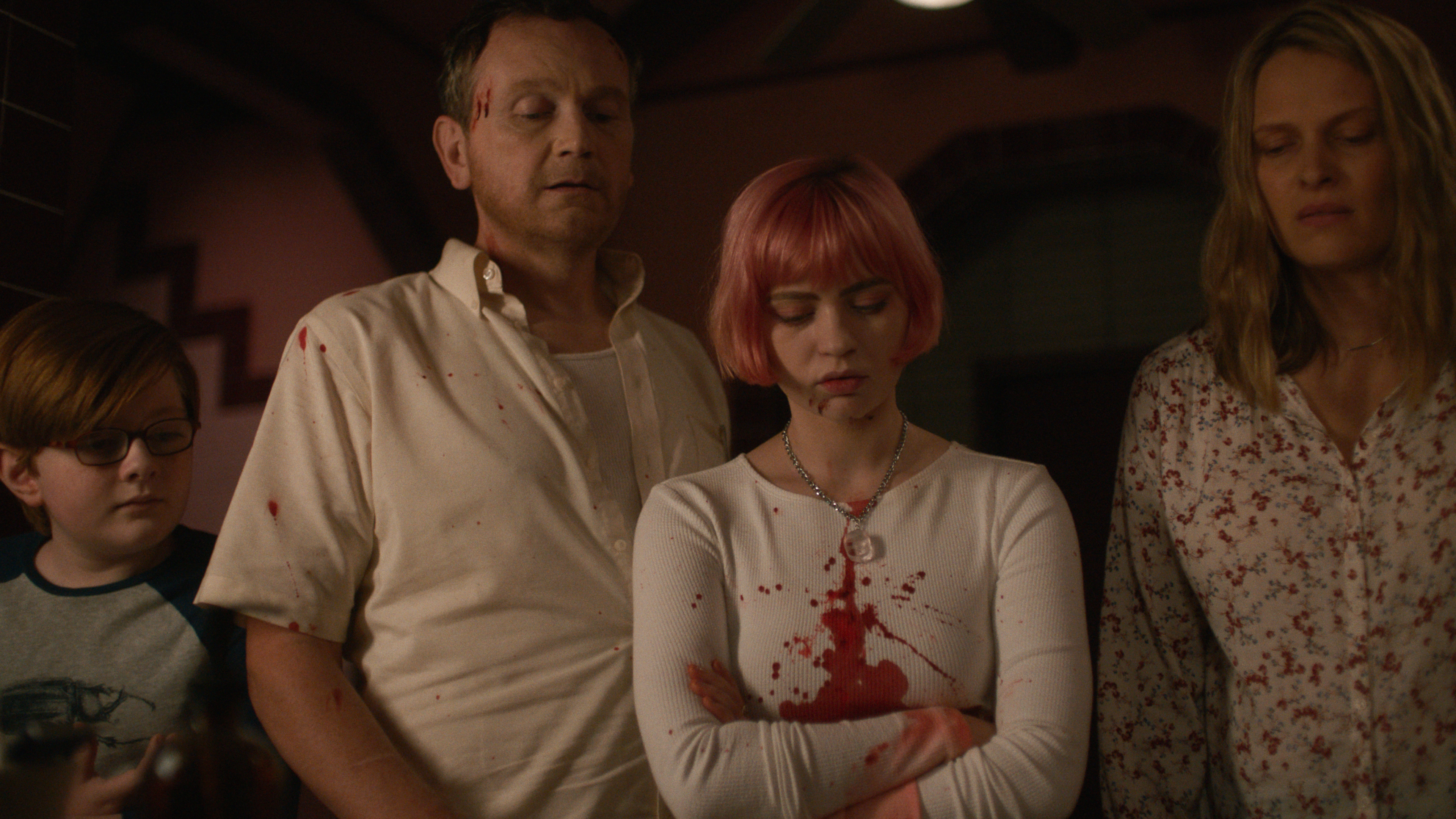 John James Cronin, Pat Healy, Sierra McCormick, and Vinessa Shaw stand next to each other covered in blood and looking down at something disgusting in the movie We Need to Do Something.